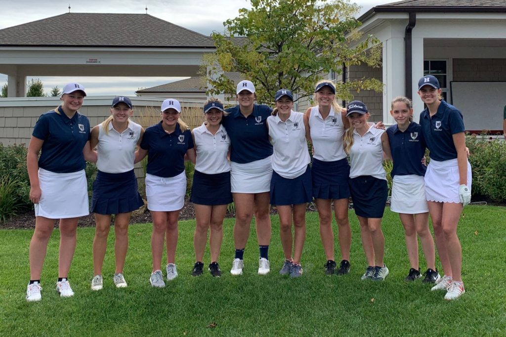 Members of the girls golf team standing together in a line.
