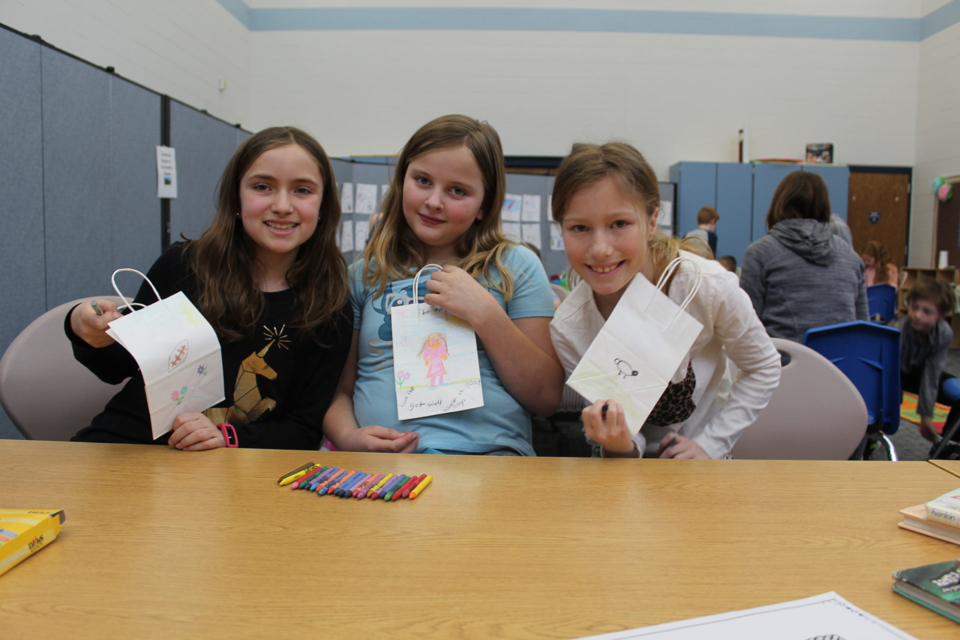 A group of girls show their Valentines bags.